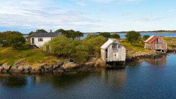 Free stock footage: Abandoned houses by the shore