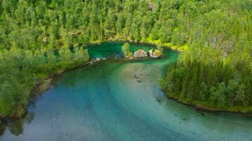 Free stock footage: Aerial view of a clear shallow river