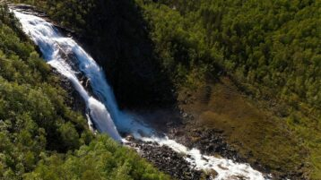 Free stock footage: Aerial view of a waterfall seen sideways