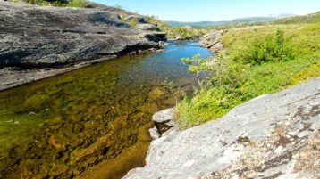 Free stock footage: Clear river in a mountain landscape