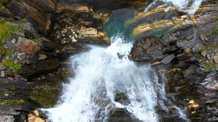 Free stock footage: Drone descending towards a waterfall