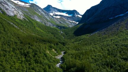 Free stock footage: Flying above a green valley in the mountains
