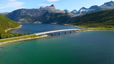 Free stock footage: Flying over a bridge crossing a fjord