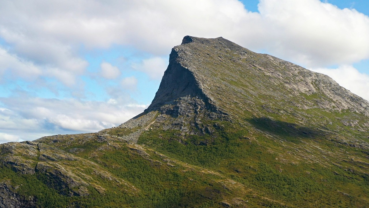 Free stock footage: Flying slowly towards a mountain peak