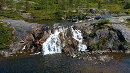 Free stock footage: Hovering in front of a small waterfall