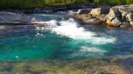 Free stock footage: River flowing down into a deep pool
