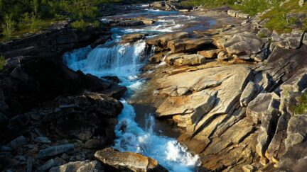 Free stock footage: River rushing down a rocky landscape
