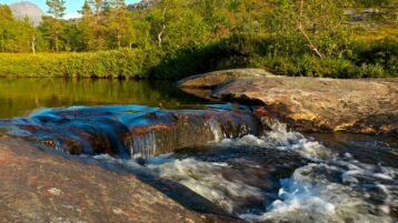 Free stock footage: Small waterfall on a late summer evening