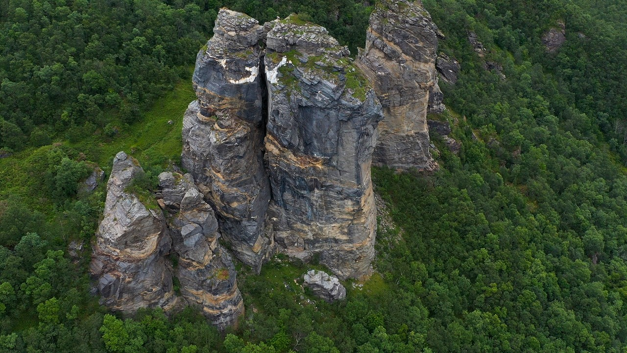 Free stock footage: Steep rock formation in the green forest