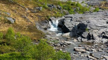 Free stock footage: Waterfall flowing down the mountainside