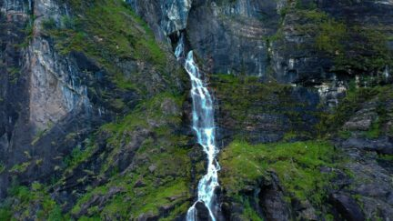 Free stock footage: Waterfall flowing out the mountainside